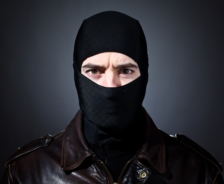balaclava: closeup portrait of caucasian criminal with balaclava