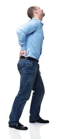 back ache: young man with pain in his back isolated on white Stock Photo