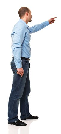 standing man: young caucasian man pointing isolated on white background Stock Photo