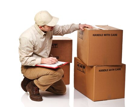 delivery package: portrait of delivery man and box isolated on white background Stock Photo