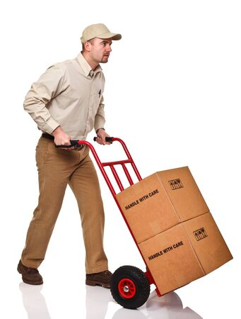 handtruck: young caucasian manual worker with handtruck on white background Stock Photo