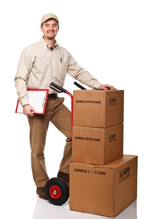 standing delivery man with red handtruck on white background photo