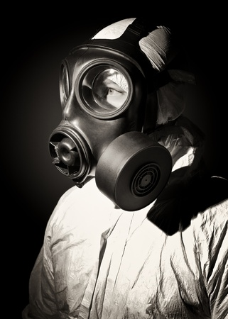 fine sepia portrait of man with gas mask photo