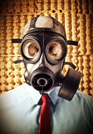 portrait of businessman skull wearing classic gas mask photo