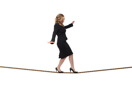 young blonde acrobat on rope isolated on white photo
