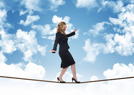 wire rope: woman on rope and blue sky with clouds Stock Photo