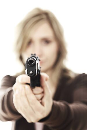 portrait of young woman pointing her gun selective focus image photo