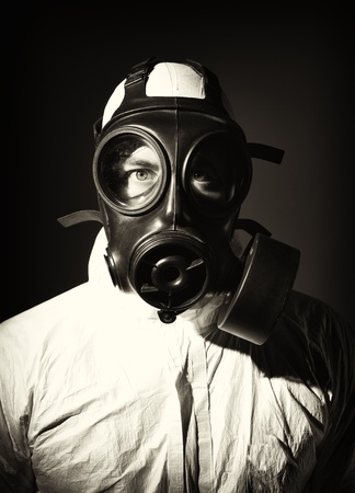 portrait of man wearing gas mask and protection clothes photo
