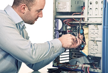 repair man: man try to repair his pc on white background Stock Photo