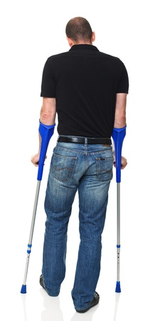 man with crutch isolated on white background photo