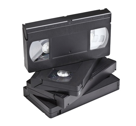 videocassette: detail of classic vhs cassette isolated on white
