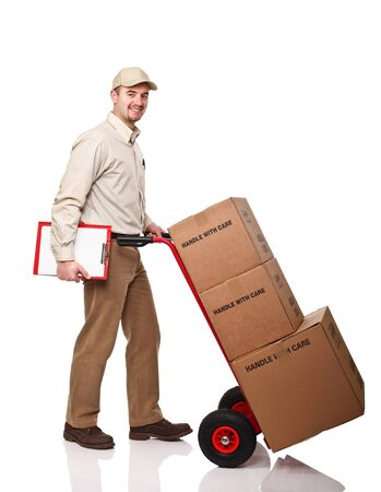handtruck: smiling delivery man with red handtruck on white background