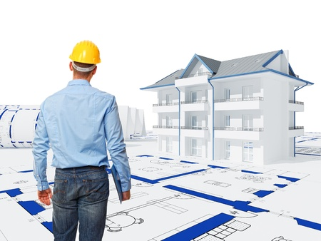building construction: standing worker back view and 3d house