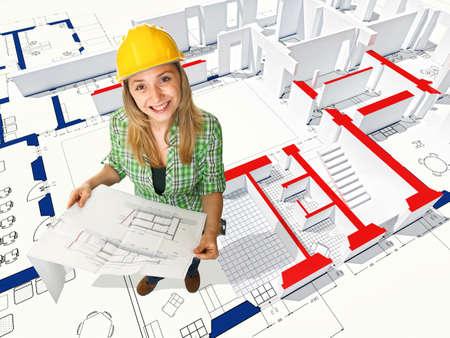 smiling manual worker on 3d blueprint model photo