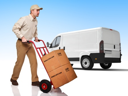 ship package: delivery man with handtruck and truck background