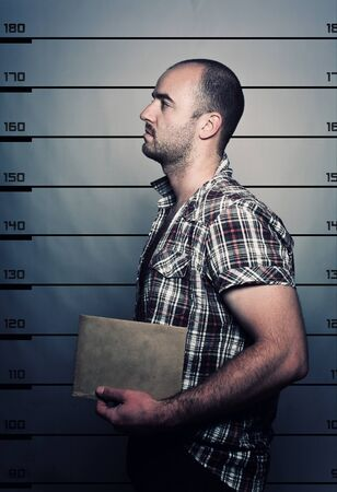 arresting: classic police photo of arrested criminal