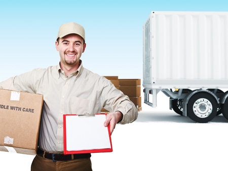 delivery service: portrait of delivery man and truck background Stock Photo