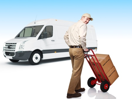 smiling caucasian worker in uniform with handtruck photo
