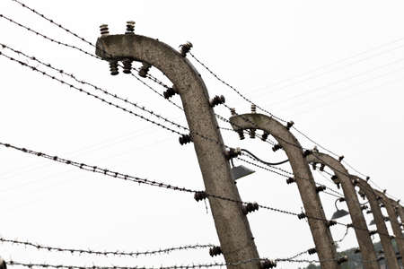 nazism: electric fence detail of  birkenau, auschwitz Stock Photo