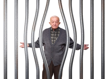 portrait of isolated on man in prison with bended bar Stock Photo - 10096009