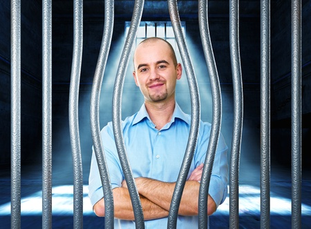 bended: portrait of man in jail with bended metal bar Stock Photo