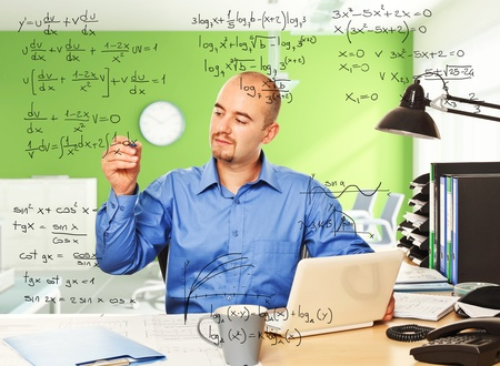 young man in office write maths formula photo