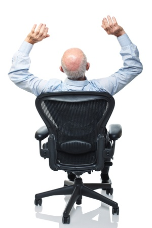 senior worker take a rest on modern office chair Stock Photo - 10213456