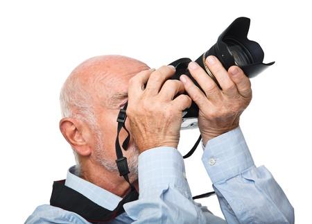 portrait of senior caucasian man with camera isolated on white Stock Photo - 10213457