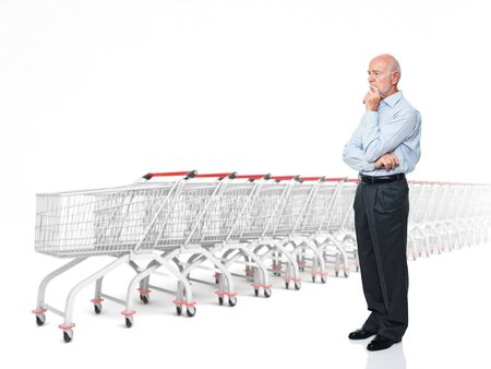 shopping questions: standing senior caucasian man and 3d trolley Stock Photo