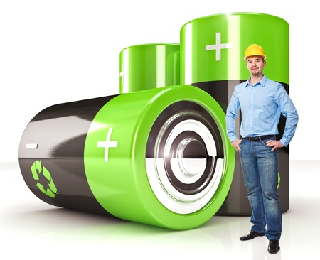 electrical engineer: standing worker and  green eco battery background Stock Photo