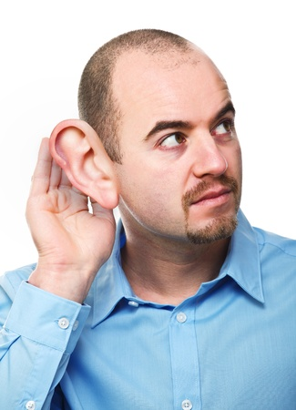 big ear:  man portrait in listen pose isolated on white background with huge ear