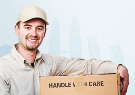 ship package: smiling delivery man and asian town background