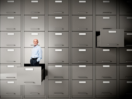 storage container: senior businessman in file cabinet drawer Stock Photo