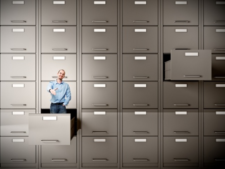 drawer: young businessman in file cabinet drawer