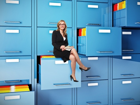 drawer: businesswoman sit on drawer of  cabinet folder