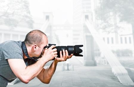 paparazzi: young caucasian  photographer in singapore Stock Photo