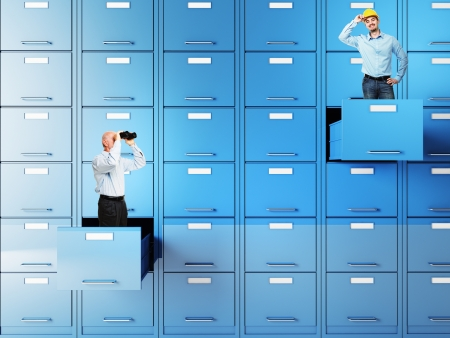 businesspeople in 3d file cabinet drawer photo