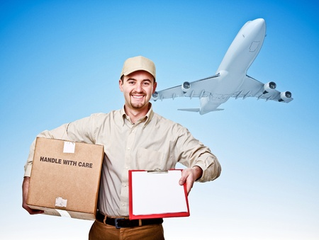 caucasian delivery man and airplane photo