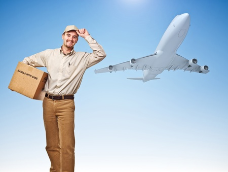 smiling delivery man and cargo airplane photo