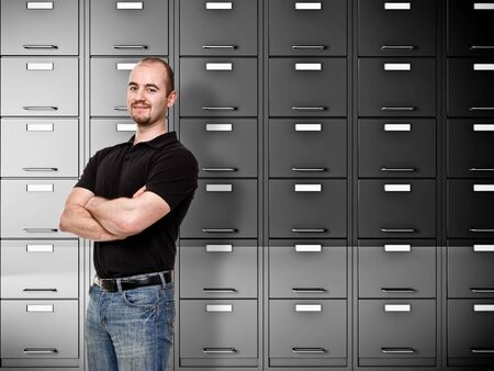 portrait of caucasian worker and file cabinet background Stock Photo - 10659406