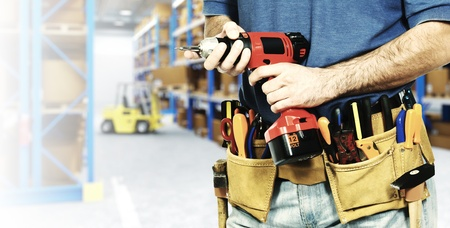 manual worker detail and 3d warehouse background photo
