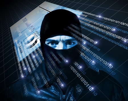 computer hacker: hacker with black balaclava portrait Stock Photo