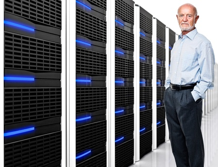 man and  datacentre with lots of server photo