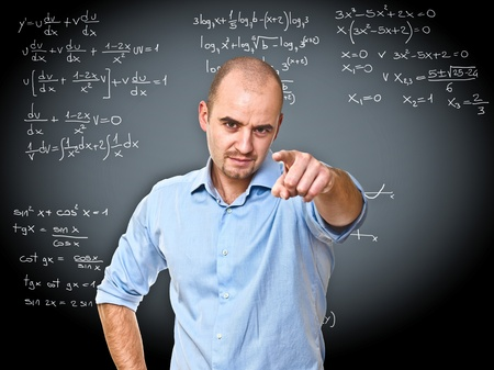 male teacher: portrait of young teacher and black board background Stock Photo