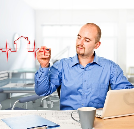 man in office drawing house metaphore Stock Photo - 10749275