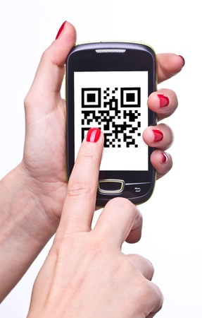 qr code: hand holding smartphone with qr code