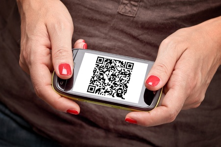 detail on smartphone with qr code on screen photo