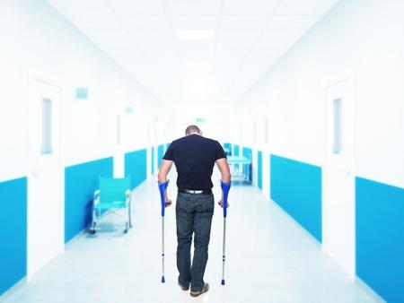 back injury: man injured in hospital back view