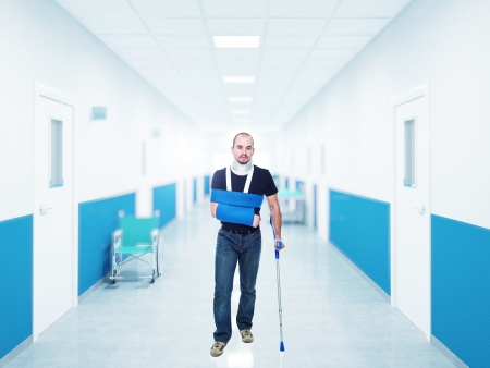 portrait of caucasian injured man in hospital photo