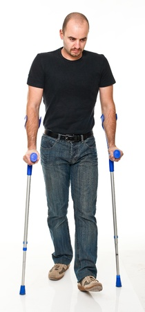 crutch: young man with crutch isolated on white